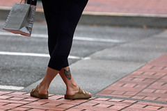Modern Shopper (Ian Sane) Tags: ian sane images modernshopper crossleggedpose birkenstocks waterbottle lowerlegtattoo blackleggings nordstromshoppingbag candid street photography downtown portland oregon southwest broadway canon eos 5ds r camera ef100400mm f4556l is usm lens