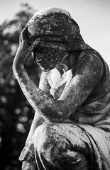 In the mourning (Sarah Rausch) Tags: cemetery sculpture canona1 ilfordhp5 film analog filmisnotdead monochome monochromemonday mono bw 50mm mourning 14 blackandwhite bokeh 2019 homedevelopedfilm 400 grainy depth 35mm targettext