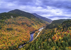 Adirondacks_1 (abhijitcpatilphotography) Tags: fall foliage fallfoliage fallcolors autumn aerial drone droneshot birdseyeview aerialphotography colors leaves trees mountains adirondacks clouds sky valley landscape red