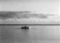 Multi-Expo: Fiskebåd (Lars_Holte) Tags: pentax 645 pentax645 645nii 6x45 smcpentaxfa 80160mm f45 120 film 120film analog analogue foma fomapan fomapan200 fomapan200creative 160iso rodinal aph09 mediumformat blackandwhite classicblackwhite bw monochrome filmforever filmphotography ishootfilm larsholte homeprocessing denmark danmark nivå morning multiexpo multiexposure seascape fishing boat øresund