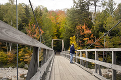 White Mountains New Hampshire Lincoln Trailhead fall colors (watts photos1) Tags: white mountains new hampshire lincoln trailhead fall colors foliage color fallcolors red yellow tree trees bridge forest people nh
