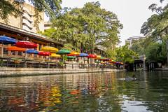 Riverwalk Umbrellas (aaronrhawkins) Tags: riverwalk sanantonio texas umbrellas reflection water duck colors river bank tourism morning peaceful aaronhawkins