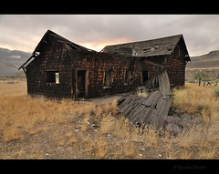 south side (Gordon Hunter) Tags: morning roof porch veranda collapse fall fell decay weathered dark wood sun hot dry arid climate desert hills house home station old derelict canada gordon hunter nikon d5000 summer