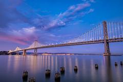 Bay Bridge (j1985w) Tags: california sanfrancisco sanfranciscobay bridge sky clouds sunset water ocean longexposure