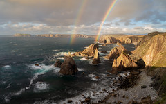 Pinnacles of Light (http://www.richardfoxphotography.com) Tags: mangerstaseastacks isleoflewis coastal coast coastline sea ocean scotland outerhebrides island rainbow doublerainbow panorama sky outdoors rock shoresline clouds sunset