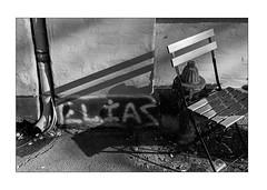 'Elias' - Chair with shadows (K.Pihl) Tags: chair leicam5 50mmsummiluxf14 monochrome shadows blackwhite hc110b schwarzweiss pellicolaanalogica grafitti bw kodaktrix400320 film analog