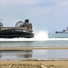Landing craft, Air Cushion 21 approaches the beach while USS Green Bay is anchored off the coast