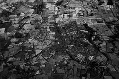 Early morning flight out of Manchester (Niaic) Tags: landscape aerial aeroplane window monochrome blackandwhite contrast texture sunrise morning flight england manchester zeiss loxia 250