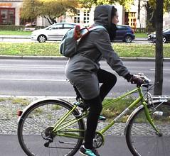 Karl Marx Allee (thomasgorman1) Tags: woman riding rider cyclist bicycle street streetshots boulevard germany berlin public cars road travel