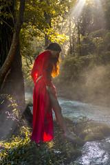 Lothlórien, by the stream of the Nimrodel (*Ranger*) Tags: red fantasy lordoftherings filteredsunlight fog stream water lady woman nikond3300 sunbeam sunray model