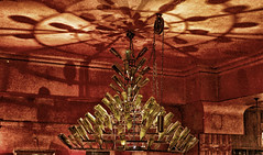 Drunken Chandelier (tcees) Tags: lafourmi paris france x100 fujifilm finepix urban streetphotography street restaurant cafe bar pub bottles ceiling chain shadow pulley chandelier pattern wall light night art abstract red ceilingrose glass