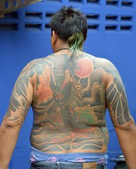 pony tail and a colorful kuan yin tattoo (the foreign photographer - ฝรั่งถ่) Tags: colorful kuan yin kwan man fat pony tail khlong lard phrao bangkhen bangkok thailand nikon d3200
