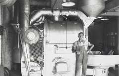 Andy Rae and coffee roasting machine, Bushells Tea Factory, Sydney, 1936 (State Library of New South Wales collection) Tags: bushells tea manufacturing sydney 1930s coffee workers harrington atherton street therocks kismet wylde demolished houses