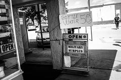X1004580 (alhawley) Tags: american bw usa acros blackandwhite candid everytownusa fujifilmx100f grain gritty humor monochrome street streetphotography flikrexplore