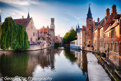 Bruges  with water canal at Late Afternoon, Flanders, Belgium (George Oze) Tags: exterior gothic rozenhoedkaaicanal afternoonlight architecture attraction belfry belgian belgium belltower brickhouses bruges brugge building buildingexteriors canal channel charming city cityscape clock clouds colorful daytime europe european evening flanders flemish heritage historic historicpeaceful horizontal house landmark landscape medieval old oldtown outdoor outdoors ppeople quaint relaxing restaurant river scenic sky street summer sunset terrace tourism tourists tower town travel tree water