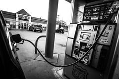 XPR29483 (alhawley) Tags: american americanabstract americana bw usa acros blackandwhite candid everytownusa fuelpump fujifilmxpro2 incar monochrome mundane neigborhood samyang12mmf2ncs shadow street streetphotography