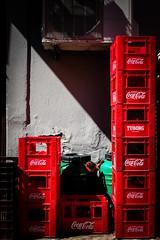 Kefalonia (Keith Vaughton) Tags: kefalonia streetphotography minimal shadows light cocacola coke red travel