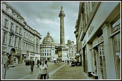 A Newcastle Impression, (tony allan tony allan) Tags: street streetphotography streetlife road people monument sky shops sepia mono monochrome newcastle nikond5300