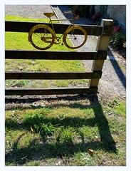 Tour de Yorkshire (overthemoon) Tags: uk northyorkshire scarborough wykeham thefatpheasant restaurant café garden fence bicycle decoration shadow shadowonthegrass england