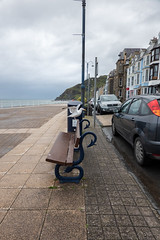 No One Looking (Jocey K) Tags: triptoukanderoupe2019 june uk wales aberystwyth sea seaside cars evening beach seat seagull birds bin rubbishbin sky clouds building architecture hills