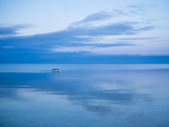 A Lonely Boat (Anthony Kernich Photo) Tags: stansbury yorkepeninsula southaustralia australia sa travel roadtrip sunset bluehour blue twilight dusk evening dark night sun symmetry simple minimal minimalist boat water sea ocean shore coast gulfstvincent olympusem10 olympus olympusomd outdoor pleasant flickr flickrheroes vessel horizon landscape reflection nature scenery microfourthirds lumix