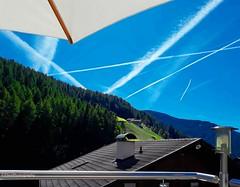 Lines in all directions (Fay2603) Tags: southerntirol altoadige sarntal durnholz linien lines roof dach geländer sonnenschirm mountains berge lampe lamp kamin chimney building gebäude wald forest bäume trees chemtrails sky himmel cielo ciel blue blau bleu azzurro green grün verde vert