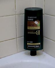Getting the Last Bit (Coyoty) Tags: crazytuesday upsidedown shampoo tub bathtub shower bathroom tiles brand bottle lines rows beige white green tresemme corner