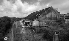 Treviscoe Loading Sheds (Rogpow) Tags: chinaclay cornwall industrial littletreviscoe treviscoe railway shed derelict dilapidated fujixpro2 mono monochrome blackandwhite bw blackwhite whiteandblack