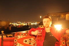 Blurry Night (Jamie Hennessy Jackson) Tags: canon eos portrait person night city cityscape drinking drink blur blurred light sky metropolis colour colours red photoshop photomanipulation bokeh lights istanbul turkey travel