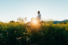 Sunset ride (Nicola Pezzoli) Tags: italy italia lombardia val seriana bergamo leffe gandino nature natura moto bike ciao piaggio sunset man silhouette sun flare prato field grass cerida