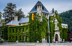 2019 - Road Trip - 164 - Nelson - 2 - Courthouse 1909 (Ted's photos - Returns late November) Tags: 2019 bc britishcolumbia canada cropped nikon nikond750 nikonfx tedmcgrath tedsphotos vignetting nelsoncourthouse streetscene street building ivy nelsonbc courthouse dormer streetlight streetlamp oldbuilding canadianregisterofhistoricplaces nelsoncanadianregisterofhistoricplaces canadianregisterofhistoricplacesnelson chimney cans2s