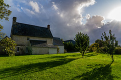 An old French Farmhouse located in Normandy (pa_cosgrove) Tags: normandy france farmhouse farm sky clouds trees grass chimney landscape sun sony a73