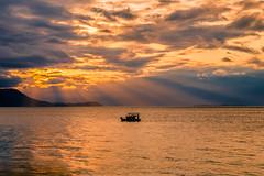 Fishing at sunset (Vagelis Pikoulas) Tags: sun sunset greece fishing boat rays landscape sea seascape tokina 2470 canon 6d