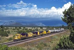 Greetings from Flagstaff (jamesbelmont) Tags: piggyback trailers sd45u sd402 emd clouds volcano sanfranciscopeaks transcon winona arizona flagstaff atchisontopekasantafe santafe
