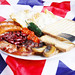 Full English breakfast, traditional meal, UK national flag background