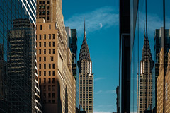New York City / USA - NOV 27 2017: Chrysler Building with moon view from 42nd street at sunset (CCYMINUM) Tags: brooklyn longexposure america american apartment architectural architecture art attraction balance bilateralsymmetry blackandwhite building buildings chrysler church city cityscape contemporary contemporaryart deco design destination diagonal district empire ethereal exterior extremedepth famous financial freedom geometry high icon landmark life lights lookingup manhattan metropolis metropolitan midtown minimal modern monochrome moon newyorkcity ny nyc office peaceful perspective quiet scene serenity sky skyline skyscraper skyscrapers street structure sunset symmetricalarchitects tourism tourist tower urban us view