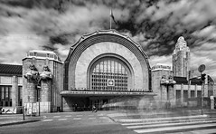 _DS11253 - A beggar at Helsinki Central Station (AlexDROP) Tags: 2019 finland helsinki europe travel architecture bw cityscape city clouds station nikond750 tamronaf1735mmf284diosda037 best iconic famous mustsee picturesque postcard longexposure street wideangle
