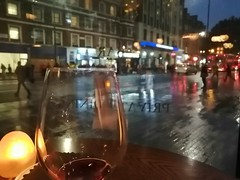Evening in London coming to an end. (BKNielsen4) Tags: london glass wine rain tube bus window restaurant street foreground blurry lights
