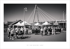 By the Marine Lake (Parallax Corporation) Tags: southportpromenade southportpier millenniumbridge blackwhite sonya7rii sony35mmf18 marinelakecafe parasols holidaymakers tourists peoplewatching kingsgardens seasidetown merseyside