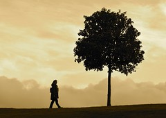 The Tree On The Hill (Edinburgh Photography) Tags: landscape tree woman walking horizon sky clouds silouhette sepia monochrome calton hill edinburgh nikon d7000