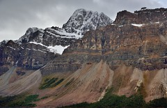 A Mountainside with Peaks and Glaciers (Banff National Park) (thor_mark ) Tags: nikond800e day4 triptoalbertaandbritishcolumbia icefieldsparkway banffnationalpark overcast crowfootmountain vulturepeak lookingsouth lowclouds capturenx2edited colorefexpro outside nature landscape mostlycloudy rockymountains canadianrockies mountains mountainsindistance mountainsoffindistance mountainside vicinitysimpsonsnumtijahlodge snowcapped mountainvalley travelingicefieldsparkway travelingtheicefieldsparkway continentaldivide lookingtocontinentaldivide lookingtomountainsofthecontinentaldivide centralmainranges waputikmountains waptaicefield project365 alberta canada