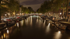Amsterdam at Night (pboolkah) Tags: amsterdam northholland netherlands canon canon5d canon5dmkiv city cityscape night lights reflections water canal boats boat