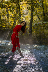 Lothlórien, by the stream of the Nimrodel (*Ranger*) Tags: red nikond3300 fantasy lordoftherings stream water forest woodland outdoors nature woman lady sunbeam sunray fog model