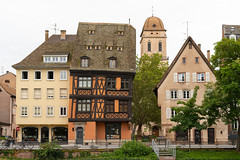 Strasbourg - Old house and church (Istvan SZEKANY) Tags: strasbourg istvanszekany building house architecture town old urban outdoors facade tree water property outdoor front neighborhood medievalarchitecture home church river dock cityscape background sonya7r3 sonya7riii sonyfrance culture heritage traditional city roof castle tower grass street brick window noperson spire neighbourhood travel small highrise residentialarea green dome bicycle sitting estate downtown