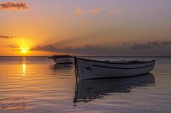 Sunset Mauritius (Malaquin Eric ........ thanks for your visits & co) Tags: fishingboat fishingboats sunset coucherdesoleil lagoon lagon mauritius ericmalaquin 35mm endoftheday atmosphere sea seaside pentax reflection water sundown sky sun twilight boat barque clouds nuages seascape sunsetmauritius colors indianocean ilemaurice