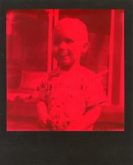 Tage (Magnus Bergström) Tags: polaroid polaroid680slr polaroidoriginals film karlstad instant instantfilm polaroidslr680 sweden sverige värmland wermland red portrait black color duochrome impossibleproject expired expiredfilm hole ekshärad hagfors busjöviken