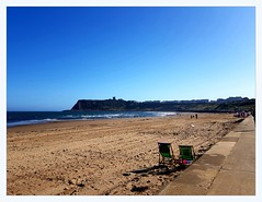 North beach and Scarborough castle (overthemoon) Tags: uk england northyorkshire seaside scarborough northbeach sand beachlife deckchairs windbreakers cliff cloudlesssky