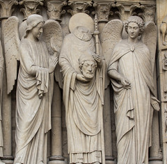 St Denis between Angels (Lawrence OP) Tags: notredame paris angels martyr bishop saint denis stone statue cathedral