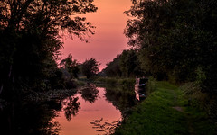 Relaxing after the sun goes down (Peter Leigh50) Tags: leicestershire landscape canal countryside sky water reflection reflections boat grand union trees tree towpath people sunset fujifilm fuji xt2 calm serene outside evening summer august shadow shadows