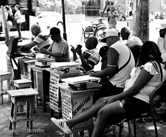 Need a letter? (stewardsonjp1) Tags: bw monochrome streetlife streetphotography sidewalk pavement document letter women men typewriter typists cartagena colombia